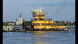 The Old Glory towing vessel appears taller than St. Louis Cathedral in the French Quarter as the Mississippi River is currently above 16 feet, which is just below flood stage at 17 feet, in New Orleans, Thursday, July 11, 2019 ahead of Tropical Storm Barry from the Gulf of Mexico. The river levees protect to about 20 feet, which the river may reach if predicted storm surge prevents the river from flowing into the Gulf of Mexico. (AP Photo/Matthew Hinton)