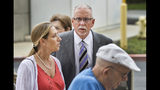 FILE - In this June 26, 2019 file photo UCLA gynecologist James Heaps, center, and his wife, Deborah Heaps, arrive at Los Angeles Superior Court. Nine more women have alleged in two lawsuits they were sexually assaulted by the former gynecologist who worked for the University of California, Los Angeles. The lawsuits say the women were groped, fondled and penetrated digitally by Dr. James Heaps during examinations between 1989 and 2017. (AP Photo/Damian Dovarganes,File)
