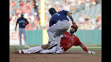 Los Angeles Angels' Albert Pujols, right, is tagged out at second base by Seattle Mariners shortstop J.P. Crawford as he tried to stretch a single into a double during the second inning of a baseball game Saturday, July 13, 2019, in Anaheim, Calif. (AP Photo/Marcio Jose Sanchez)