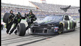 Kurt Busch makes a pit stop during the NASCAR Cup Series auto race at Kentucky Speedway in Sparta, Ky., Saturday, July 13, 2019. (AP Photo/Timothy D. Easley)
