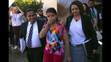 In this Dec. 17, 2018 photo, Imelda Cortez, 20, who was accused of attempting to abort her abuser's baby, walks out of court between her two defense lawyers after being found not guilty in Usulutan, El Salvador. The decision to prosecute Cortez, who had suffered years of sexual abuse by her elderly stepfather and said she did not know she was pregnant until giving birth in an outhouse, caused international outrage. (AP Photo/Salvador Melendez)