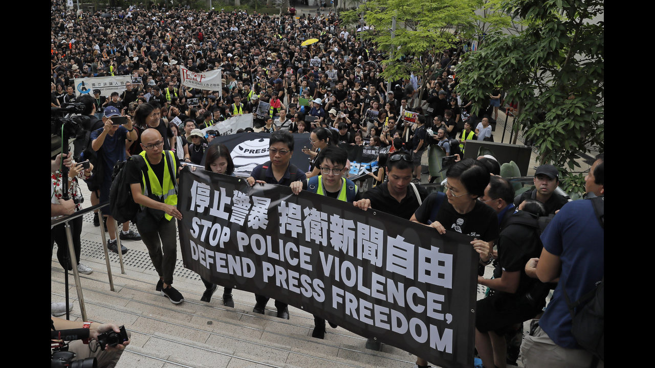 Hong Kong protesters hold new march against extradition law | WSOC-TV