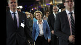 German Defense Minister and candidate for European Commission President Ursula von der Leyen, center, is escorted by security guards and her assistants between meetings at the European Parliament in Brussels, Wednesday, July 10, 2019. European Parliament groups are grilling the German candidate for European Commission president before they take a vote on her appointment next week. (AP Photo/Francisco Seco)