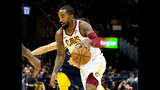 FILE - In this Oct. 8, 2018, file photo, Cleveland Cavaliers guard J.R. Smith dribbles to the basket during the first quarter of a preseason NBA basketball game against the Indiana Pacers in Cleveland. The Cavaliers waived Smith, ending his eventful tenure with the team. Cleveland tried to trade Smith, but could not find the right package and released him to cut space under the salary cap and avoid paying any luxury taxes. (AP Photo/Scott R. Galvin, File)