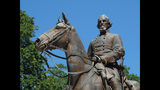 """FILE - In this Aug. 18, 2017, file photo, a statue of Confederate Gen. Nathan Bedford Forrest sits in a park in Memphis, Tenn. Republican Tennessee Gov. Bill Lee is facing backlash for signing a proclamation ordering a day to honor Forrest, an early leader of the Ku Klux Klan. Lee told reporters this week that a 1969 state law required him to sign the proclamation but declined to say whether he believed the law should be repealed. The proclamation designates July 13 as """"Nathan Bedford Forrest Day."""" Forrest was a Confederate cavalry general who had amassed a fortune as a plantation owner and slave trader in Memphis before the Civil War. (AP Photo/Adrian Sainz, File)"""