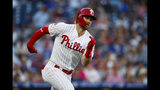 Philadelphia Phillies' Bryce Harper runs the bases after hitting a double off Los Angeles Dodgers starting pitcher Clayton Kershaw during the third inning of a baseball game, Monday, July 15, 2019, in Philadelphia. (AP Photo/Matt Slocum)