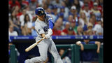 Los Angeles Dodgers' Enrique Hernandez hits an RBI-single off Philadelphia Phillies starting pitcher Zach Eflin during the fourth inning of a baseball game, Monday, July 15, 2019, in Philadelphia. (AP Photo/Matt Slocum)