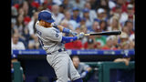 Los Angeles Dodgers' Justin Turner follows through after hitting an RBI-double off Philadelphia Phillies starting pitcher Zach Eflin during the fourth inning of a baseball game, Monday, July 15, 2019, in Philadelphia. (AP Photo/Matt Slocum)