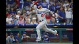 Los Angeles Dodgers' Alex Verdugo runs home to score on an RBI-double by Justin Turner during the fourth inning of a baseball game against the Philadelphia Phillies, Monday, July 15, 2019, in Philadelphia. (AP Photo/Matt Slocum)