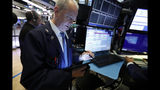 FILE - In this July 1, 2019, file photo trader James Riley works on the floor of the New York Stock Exchange. The U.S. stock market opens at 9:30 a.m. EDT on Monday, July 15. (AP Photo/Richard Drew, File)