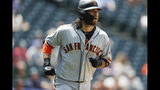 San Francisco Giants' Brandon Crawford heads up the first base line after hitting a two-run home run off Colorado Rockies relief pitcher Jesus Tinoco in the sixth inning of a baseball game Monday, July 15, 2019, in Denver.(AP Photo/David Zalubowski)