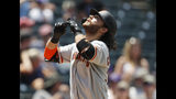 San Francisco Giants' Brandon Crawford gestures as he crosses home plate after hitting a two-run home run off Colorado Rockies relief pitcher Jesus Tinoco in the sixth inning of a baseball game Monday, July 15, 2019, in Denver.(AP Photo/David Zalubowski)