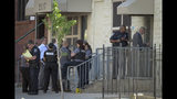Baltimore Police investigate the scene of a shooting at the Man Alive drug treatment center on Maryland Avenue Monday, July 15, 2019. At least two people are dead and a police sergeant and a woman are injured following a shooting at a methadone clinic in Baltimore, police said Monday. (Jerry Jackson/The Baltimore Sun via AP)