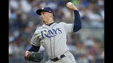 Tampa Bay Rays starting pitcher Blake Snell winds up during the first inning of a baseball game against the New York Yankees, Monday, July 15, 2019, in New York. (AP Photo/Kathy Willens)