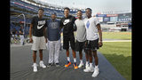 Milwaukee Bucks forward and 2019 NBA Most Valuable Player Giannis Antetokounmpo, center, and his three brothers, left, second from right, and right, pose for a photograph on the field with New York Yankees starting pitcher CC Sabathia, second from left, at Yankee Stadium before a baseball game between the Yankees and the Tampa Bay Rays, Monday, July 15, 2019, in New York. (AP Photo/Kathy Willens)