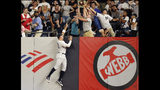 New York Yankees' right fielder Aaron Judge, left, leaps against the outfield wall but cannot reach Tampa Bay Rays' Tarvis d'Arnaud's ninth-inning three-run home run during a baseball game, Monday, July 15, 2019, in New York. (AP Photo/Kathy Willens)