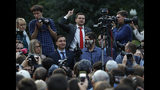 Russian opposition candidate Russian and activist Ilya Yashin, center, gestures while speaking to a crowd during a protest in Moscow, Russia, Monday, July 15, 2019. Opposition candidates who run for seats in the city legislature in September's elections have complained that authorities try to bar them from the race by questioning the validity of signatures of city residents they must collect in order to qualify for the race. (AP Photo/Pavel Golovkin)