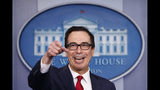 Treasury Secretary Steve Mnuchin takes questions as he speaks during a news briefing at the White House, in Washington, Monday, July 15, 2019. (AP Photo/Carolyn Kaster)