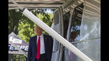 President Donald Trump steps out of an Airstream trailer from Ohio, during a Made in America showcase on the South Lawn of the White House, Monday, July 15, 2019, in Washington. (AP Photo/Alex Brandon)