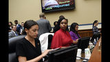 Rep. Alexandria Ocasio-Cortez, D-N.Y., left, Rep. Ayanna Pressley, D-Mass., center, and Rep. Rashida Tlaib, D-Mich., right, gather their things following the adjournment of a House Oversight Committee hearing on Capitol Hill in Washington, Monday, July 15, 2019, on White House counselor Kellyanne Conway's violation of the Hatch Act. (AP Photo/Susan Walsh)
