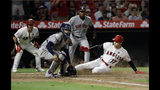Los Angeles Angels' Shohei Ohtani (17) scores past Houston Astros catcher Robinson Chirinos on a single by Albert Pujols during the fifth inning of a baseball game Monday, July 15, 2019, in Anaheim, Calif. (AP Photo/Marcio Jose Sanchez)