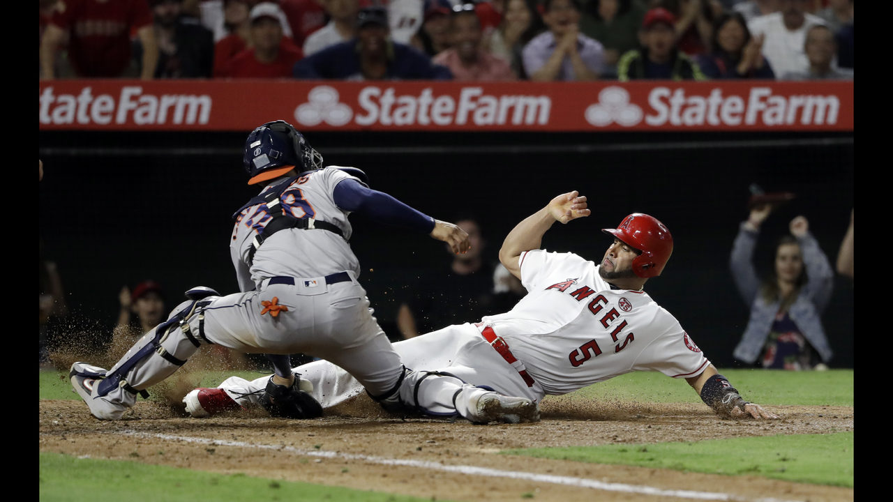 b4bc5e1a Pujols' 3 hits, 3 RBIs power streaking Halos past Astros 9-6 | WFTV