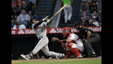Houston Astros' Alex Bregman (2) drives in a run with a single during the second inning of a baseball game against the Los Angeles Angels, Monday, July 15, 2019, in Anaheim, Calif. (AP Photo/Marcio Jose Sanchez)