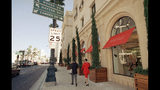 FILE - In a Jan. 11, 1996 file photo, pedestrians pass by upscale clothier Barneyís, Inc., in Beverly Hills, Calif. Luxury retailer Barneys New York may soon join the ever lengthening list of retailers seeking protection in bankruptcy. (AP Photo/Nick Ut, File)