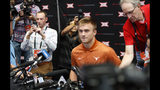 Texas quarterback Sam Ehlinger sits down for interviews during Big 12 Conference NCAA college football media day Tuesday, July 16, 2019, at AT&T Stadium in Arlington, Texas. (AP Photo/David Kent)