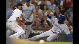 Boston Red Sox's Rafael Devers, left, can not make the play as Toronto Blue Jays' Teoscar Hernandez, right, advances to third base on a throwing error by Josh Taylor on a pickoff attempt at first base during the sixth inning of a baseball game in Boston, Tuesday, July 16, 2019. (AP Photo/Michael Dwyer)