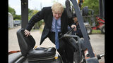 Conservative Party leadership candidate Boris Johnson in a fork lift truck during a visit to King & Co tree nursery, in Braintree, Essex, ahead of a Tory leadership hustings, England, Saturday, July 13, 2019. (Neil Hall/Pool photo via AP)