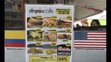 "This June 11, 2019 photo, shows the menu at the ""Arepas Cafe"" restaurant in Bogota, Colombia, Tuesday, June 11, 2019. Owner Gerson Briceño noted he takes pride in seeing Colombians become repeat customers and order classics like the reina pepiada with chicken salad and avocado. (AP Photo/Fernando Vergara)"