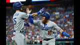 Los Angeles Dodgers' Cody Bellinger, left, and Justin Turner celebrate after Bellinger's two-run home run during the fourth inning of a baseball game against the Philadelphia Phillies, Tuesday, July 16, 2019, in Philadelphia. (AP Photo/Matt Slocum)
