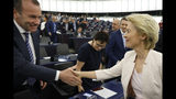 Germany's Ursula von der Leyen shakes hands with compatriot Manfred Weber after delivering her speech at the European Parliament in Strasbourg, eastern France, Tuesday July 16, 2019. Ursula von der Leyen outlined her vision and plans as Commission President. The vote, held by secret paper ballot, will take place later today. (AP Photo/Jean-Francois Badias)
