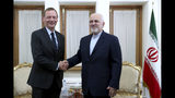 "Iranian Foreign Minister Mohammad Javad Zarif, right, shakes hand with French presidential envoy Emmanuel Bonne, as they pose for photos, in Tehran, Iran, Wednesday, July 10, 2019. France sent Bonne to Tehran to urge Iran to return to complying with the terms of the deal ""without delay."" (AP Photo/Ebrahim Noroozi)"