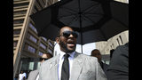 FILE - In this June 6, 2019 file photo, musician R. Kelly departs the Leighton Criminal Court building after pleading not guilty to 11 additional sex-related charges in Chicago. A U.S. Attorney's office spokesman says Kelly was arrested Thursday night, July 11 on federal sex-crime charges in Chicago. (AP Photo/Amr Alfiky, File)