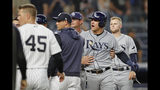 Tampa Bay Rays pitching coach Kyle Snyder, center rear, restrains Rays' Avisail Garcia, second from right, as benches and bullpens cleared during a dispute between Garcia and New York Yankees starting pitcher CC Sabathia during the sixth inning of a baseball game Tuesday, July 16, 2019, in New York. Yankees manager Aaron Boone is fourth from right. (AP Photo/Kathy Willens)