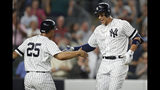 New York Yankees' Aaron Judge, right, celebrates with Gleyber Torres (25), who scored on Judge's two-run home run during the eighth inning of a baseball game against the Tampa Bay Rays, Tuesday, July 16, 2019, in New York. (AP Photo/Kathy Willens)
