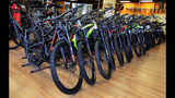 In this July 10, 2019, photo, mountain bikes are displayed at Cycles Etc bicycle shop in Salem, N.H. On Tuesday, July 16, the Commerce Department releases U.S. retail sales data for June. (AP Photo/Charles Krupa)