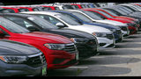 In this July 10, 2019, photo Volkswagen Jetta sedans are lined up at the Quirk dealership in Manchester, N.H. On Tuesday, July 16, the Commerce Department releases U.S. retail sales data for June. (AP Photo/Charles Krupa)