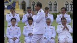 Thailand's Prime Minister Prayuth Chan-ocha arrives for a group photo with his cabinet members at the government house in Bangkok Tuesday, July 16, 2019. Prayuth on Tuesday led his 36 cabinet members to take their oath in front of Thailand's King Maha Vajiralongkorn. (AP Photo/Sakchai Lalit)