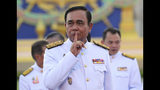 Thailand's Prime Minister Prayuth Chan-ocha reacts after a group photo with his cabinet members at the government house in Bangkok Tuesday, July 16, 2019. Prayuth on Tuesday led his 36 cabinet members to take their oath in front Thailand's King Maha Vajiralongkorn. (AP Photo/Sakchai Lalit)