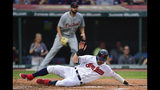 Cleveland Indians' Tyler Naquin scores on a two-run double by Francisco Lindor during the second inning of a baseball game against the Detroit Tigers, Tuesday, July 16, 2019, in Cleveland. (AP Photo/David Dermer)