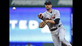 Detroit Tigers' Jordy Mercer throws to first base during the third inning of the team's baseball game against the Cleveland Indians, Tuesday, July 16, 2019, in Cleveland. Tyler Naquin was out. (AP Photo/David Dermer)