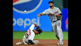 Detroit Tigers' Jeimer Candelario throws to first base after forcing out Cleveland Indians' Oscar Mercado at second base in the seventh inning of a baseball game, Tuesday, July 16, 2019, in Cleveland. Carlos Santana was out at first base. The Indians won 8-0. (AP Photo/David Dermer)