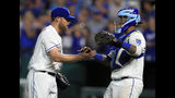 Kansas City Royals relief pitcher Ian Kennedy, left, shakes hands with catcher Martin Maldonado following the Royals' 8-5 win over the Detroit Tigers in a baseball game at Kauffman Stadium in Kansas City, Mo., Friday, July 12, 2019. (AP Photo/Orlin Wagner)