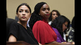 Rep. Alexandria Ocasio-Cortez, D-N.Y., left, Rep. Ayanna Pressley, D-Mass., center, and Rep. Rashida Tlaib, D-Mich., right, attend a House Oversight Committee hearing on Capitol Hill in Washington, Tuesday, July 16, 2019, on White House counselor Kellyanne Conway's violation of the Hatch Act. (AP Photo/Susan Walsh)