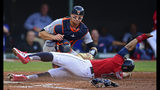 Cleveland Indians' Francisco Lindor is caught trying to steal home, tagged out by Detroit Tigers' John Hicks during the third inning of a baseball game Wednesday, July 17, 2019, in Cleveland. (AP Photo/David Dermer)