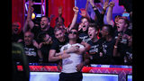 Hossein Ensan, center, of Germany, celebrates with supporters after winning the World Series of Poker main event, Wednesday, July 17, 2019, in Las Vegas. (AP Photo/John Locher)