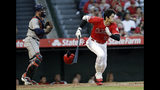 Los Angeles Angels' Shohei Ohtani heads to first on an RBI infield single against the Houston Astros during the first inning of a baseball game Tuesday, July 16, 2019, in Anaheim, Calif. (AP Photo/Marcio Jose Sanchez)